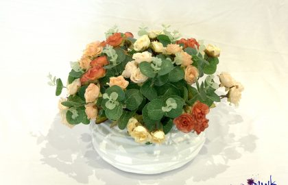 סידור ורדים קטנים בכלי קרמיקה עגול – גווני כתום